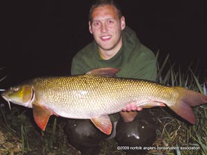 Oliver Harper with the largest barbel of the season, 11 lbs 5 ozs.